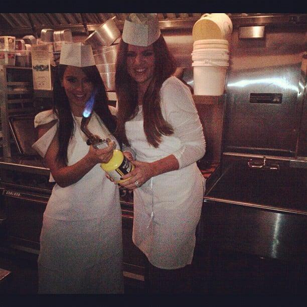 Kim and Khloé Kardashian put themselves to work in a professional kitchen. Source: Instagram user kimkardashian