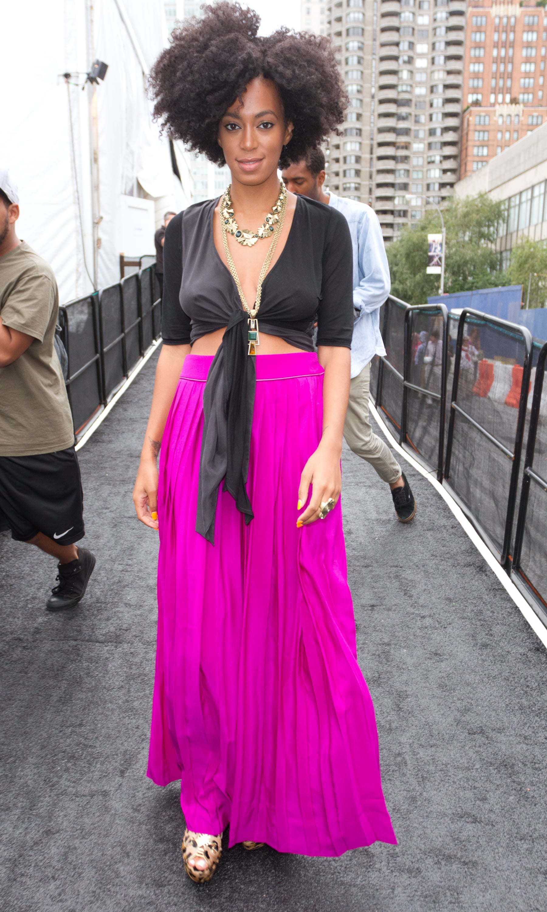 For a fun daytime look that shows a bit of skin, see how Solange does it: she paired a vibrant maxi skirt with a black, tied-up top and leopard-print heels, making for a sexy, attention-getting ensemble in September 2011.