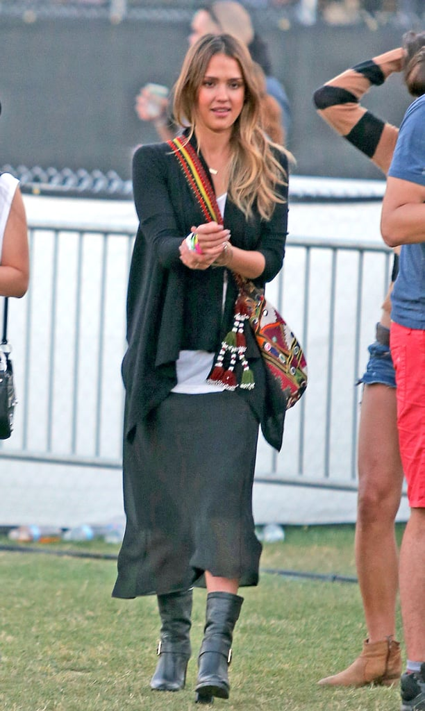 Jessica Alba gave a black skirt and boots a Coachella-appropriate twist with an eclectic crossbody bag.
