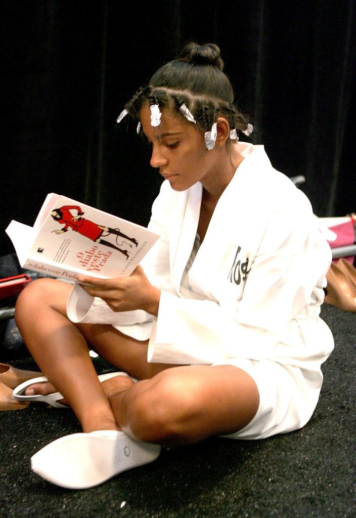 A model read Lauren Weisberger's The Devil Wears Prada — in Spanish — backstage during New York Fashion Week in 2006.