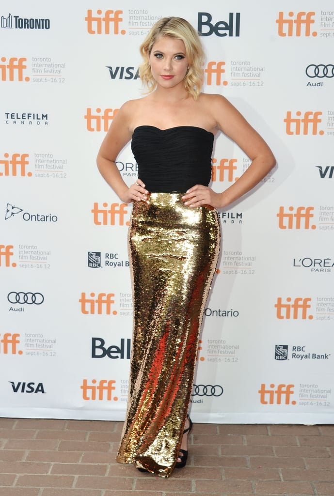 Shine factor alert! Ashley Benson turned it out for the Spring Breakers premiere in a black-and-gold lamé Dolce & Gabbana strapless gown.