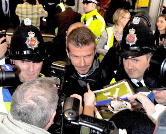 Photos of David Beckham Arriving at Manchester Airport While Victoria Beckham Grabs Dinner in LA