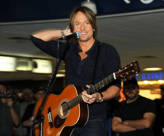 Slide Picture of Keith Urban Performing at an Amtrak Station in NYC