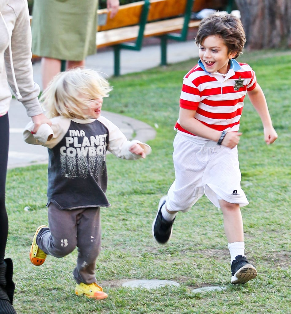 Zuma and Kingston ran side-by-side to the jungle gym.