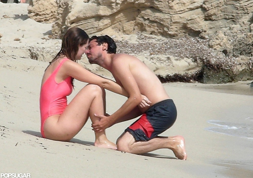 Mischa Barton wore a hot-pink swimsuit and hit the beach with her boyfriend, Sebastian Knapp, during their July 2012 stay in Ibiza.