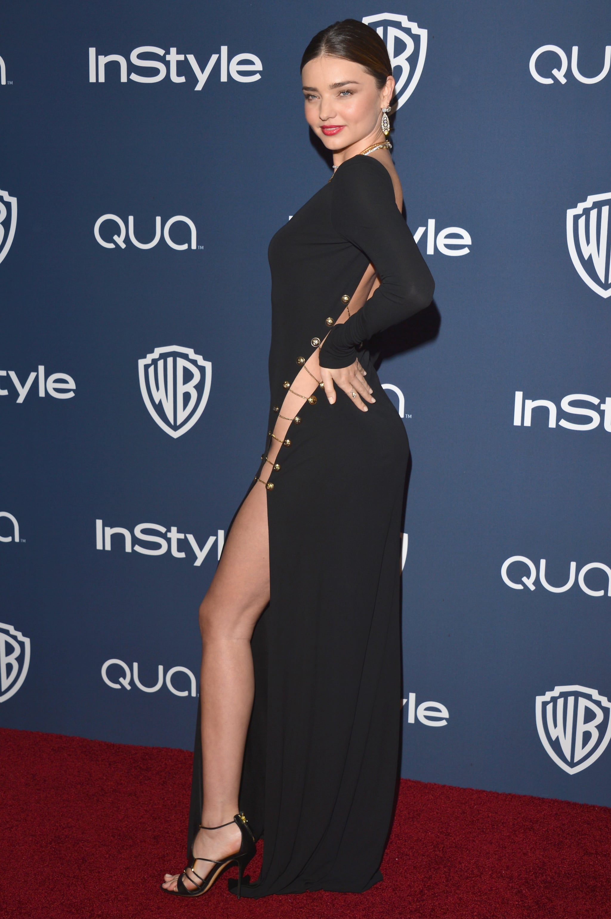 Miranda Kerr stepped out in a supersexy black dress for the InStyle and Warner Bros. Golden Globes afterparty.