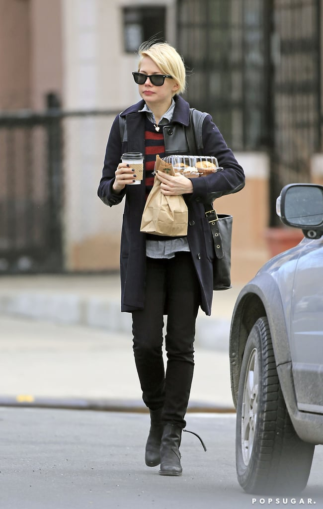 Michelle Williams held on to her coffee and food.