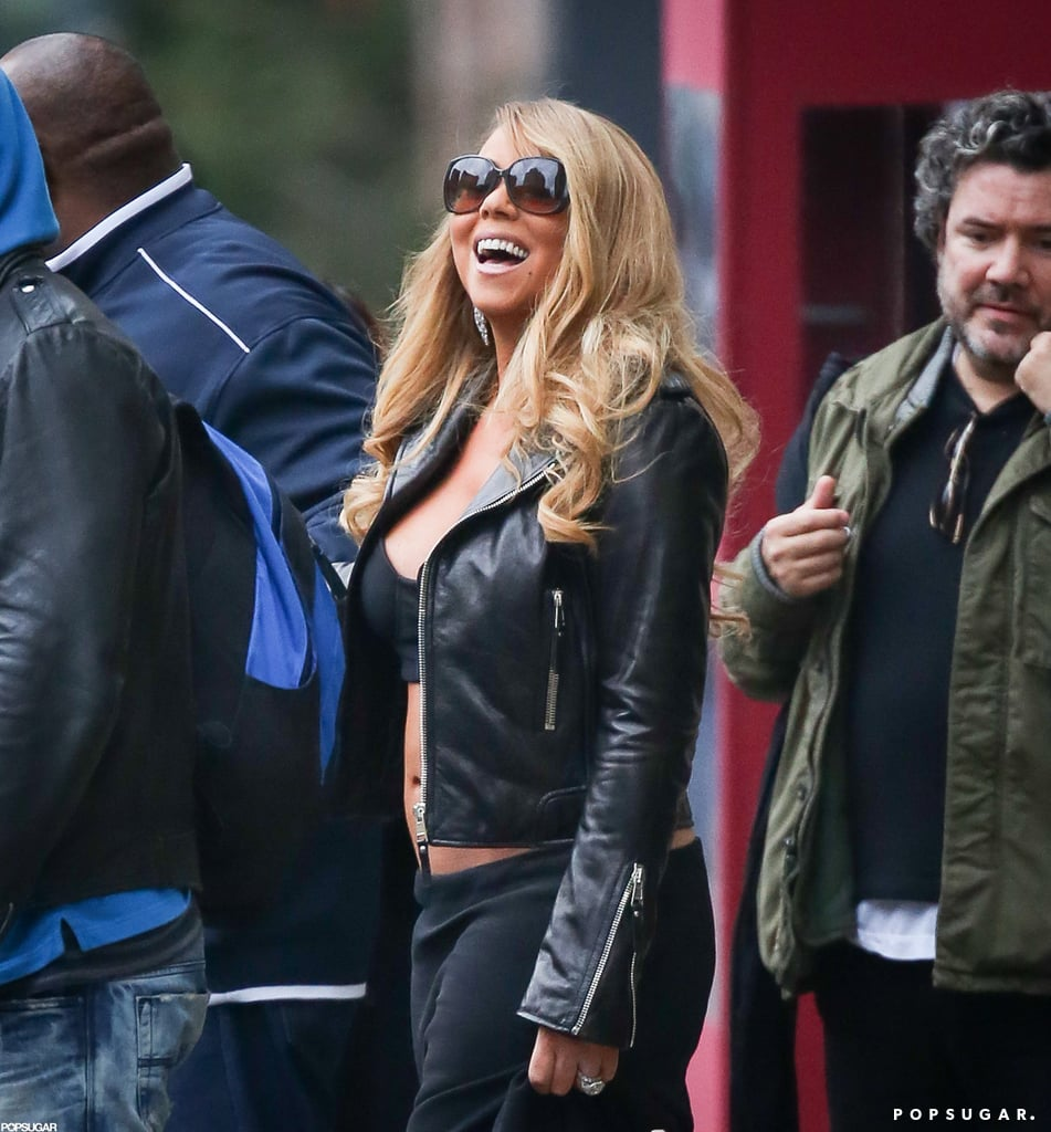 Mariah Carey laughed while walking out in NYC.