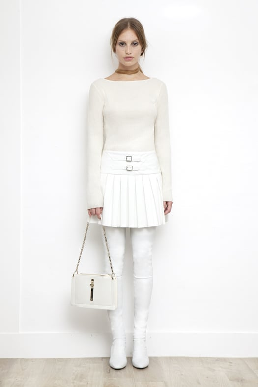 Knit Boatneck Top With Pleated Skirt Combo Dress in Cream ($895), Sweet Revenge Stretch Nappa Legging Boot in Cream ($2,395), Attraction Patent Shoulder Bag in Cream ($1,795) Photo courtesy of Tamara Mellon
