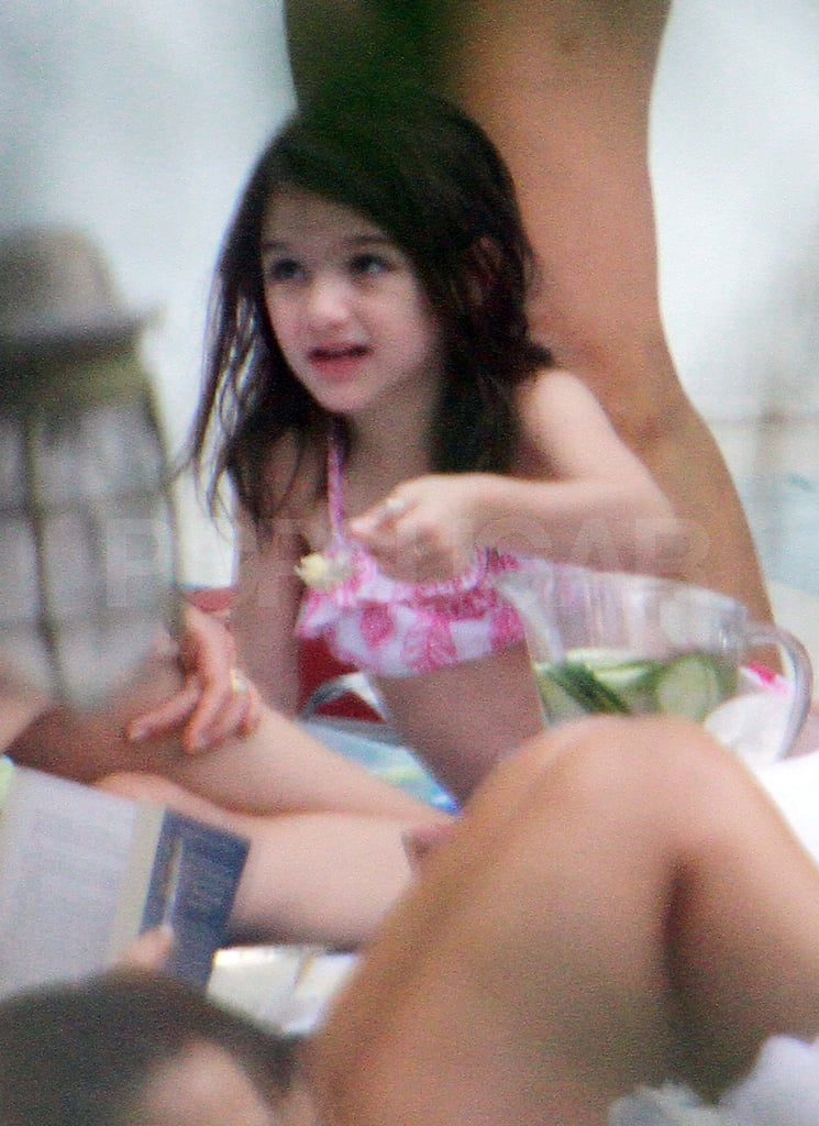 Suri Cruise by the pool in Miami.