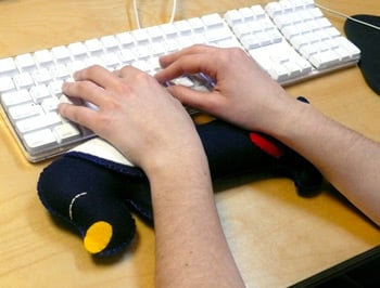 Totally Geeky or Geek Chic? Sleepy Dog Wrist Cushion