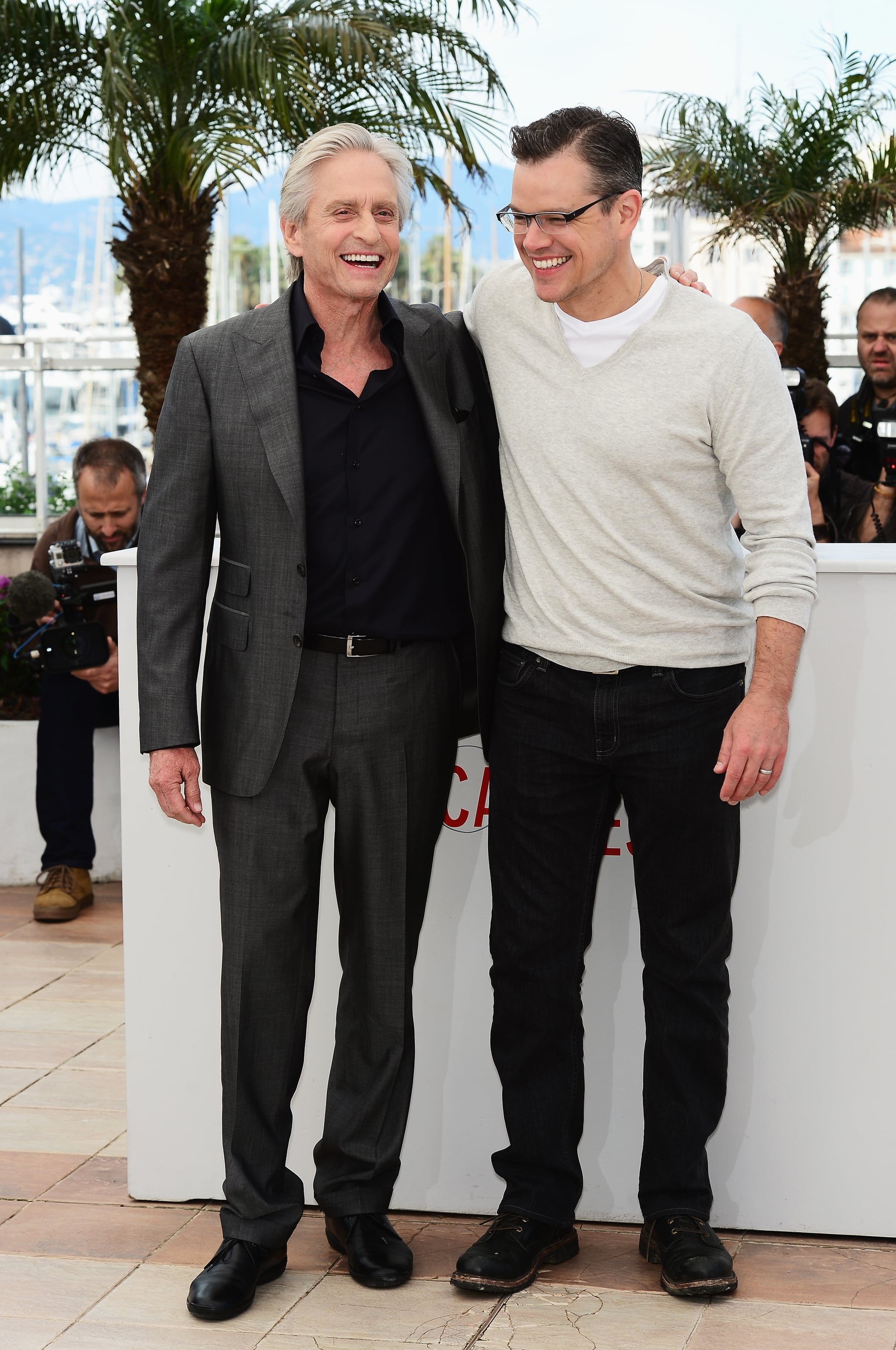 Matt Damon shared a laugh with Michael Douglas at the Behind the Candelabra photocall in Cannes on Tuesday.