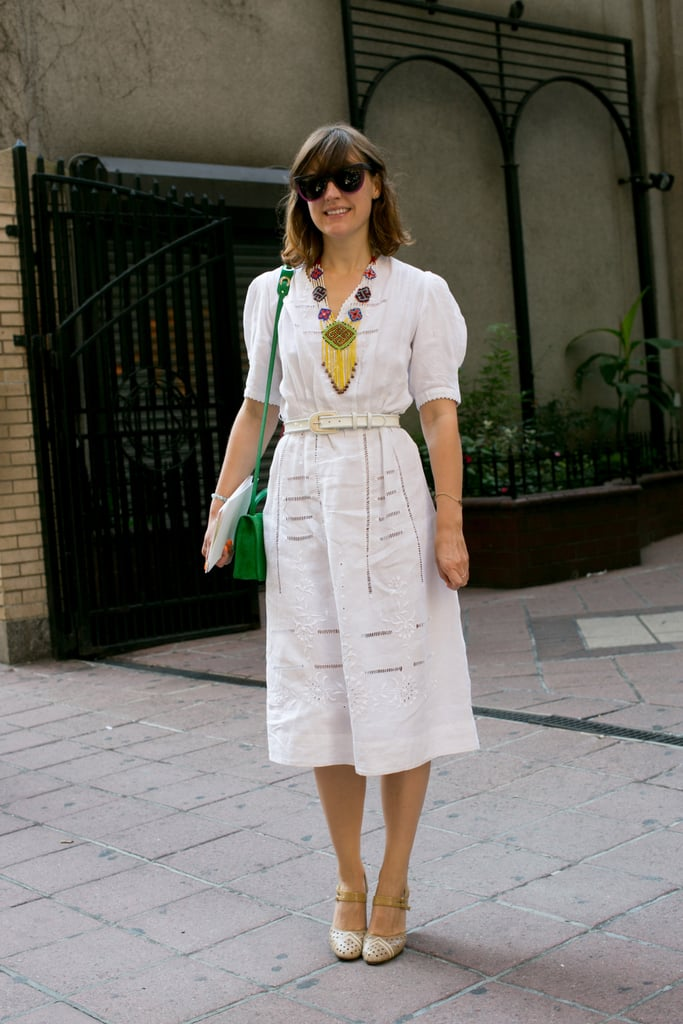 This showgoer dressed up a pretty white dress with bright add-ons.