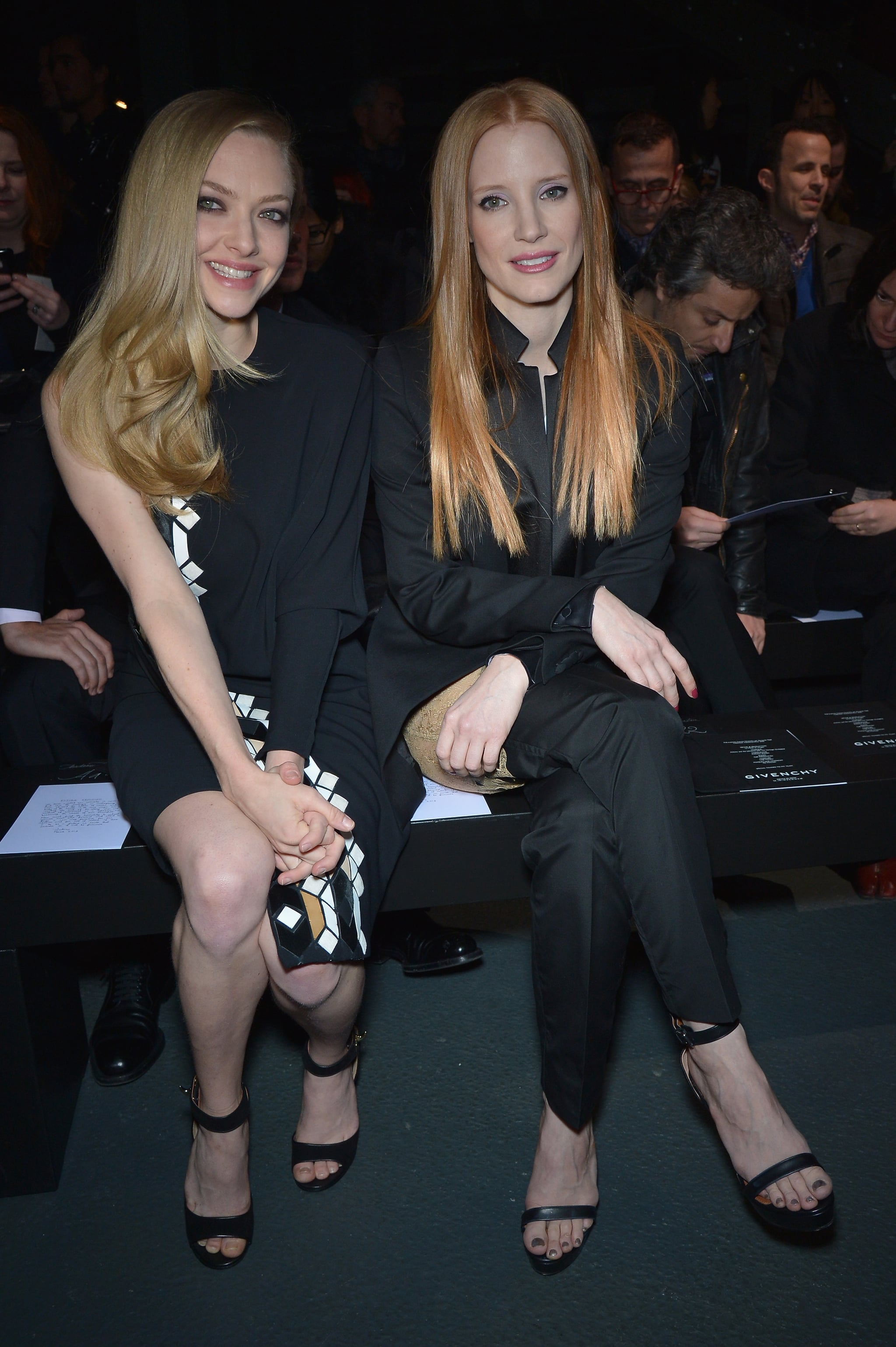 Jessica Chastain sat next to Amanda Seyfried at the Givenchy show on Sunday.