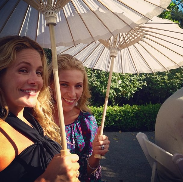 CaCee Cobb and a pal held onto parasols during the ceremony.  Source: Instagram user asands78