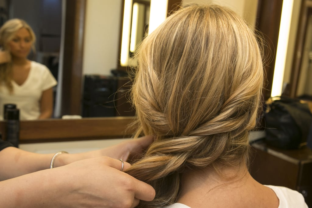 Guillen created a loose, inside-out braid (meaning she braided each section under instead of over) to add to the woven texture of the look. But, again, a simple twist would work just as well.