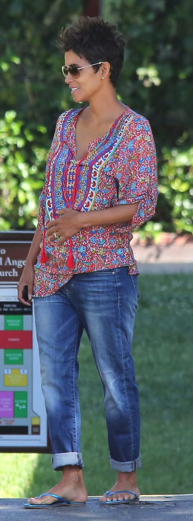 Halle hasn't worn much denim during her pregnancy so far, but here the actress matched a colorful tunic with slouchy boyfriend-style jeans, then added blue metallic flip-flops and aviator sunglasses.