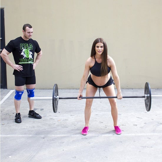 Pregnant Model Lifting Weights