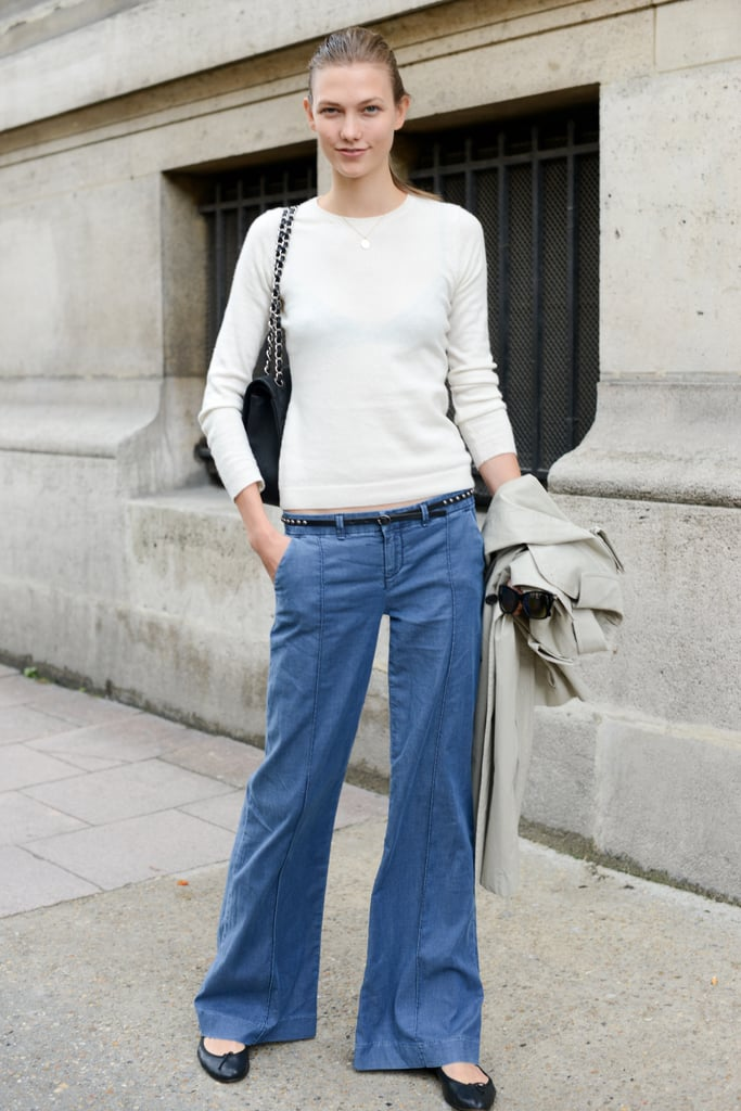 Karlie Kloss kept it simple in a pair of flares and a snug knit.