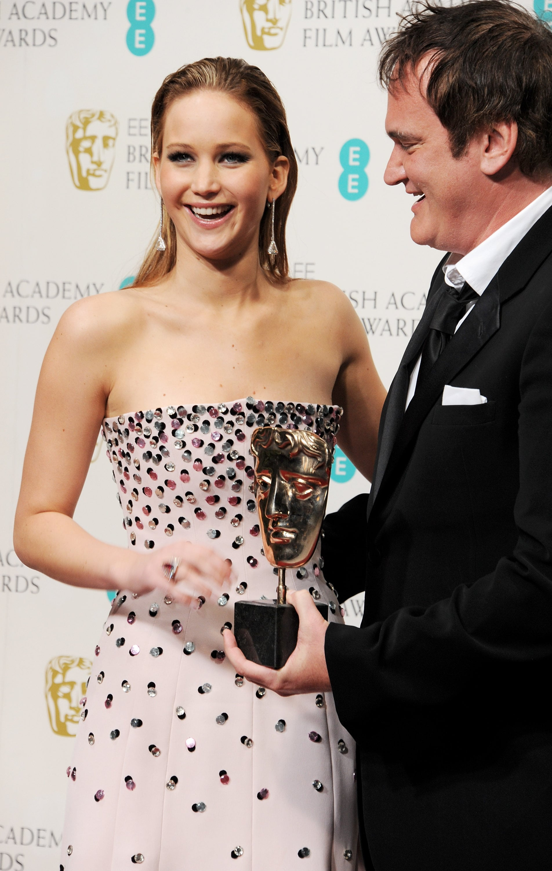 Jennifer Lawrence posed with Quentin Tarantino after presenting him with the best original screenplay award in the press room at the BAFTAs in February in London.