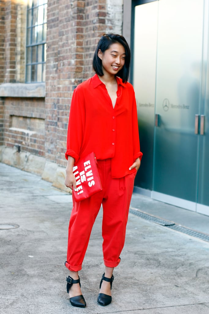 An all-red ensemble was punctuated with a statement clutch and effortless flats.