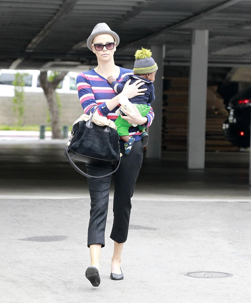 Charlize Theron dress Jackson in a beanie and green pants.
