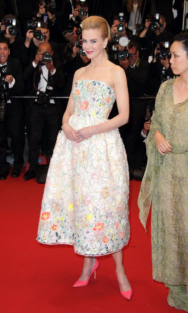 Nicole Kidman was a vision of polished ladylike perfection in a Dior Haute Couture dress with painterly floral details and hot-pink shoes.