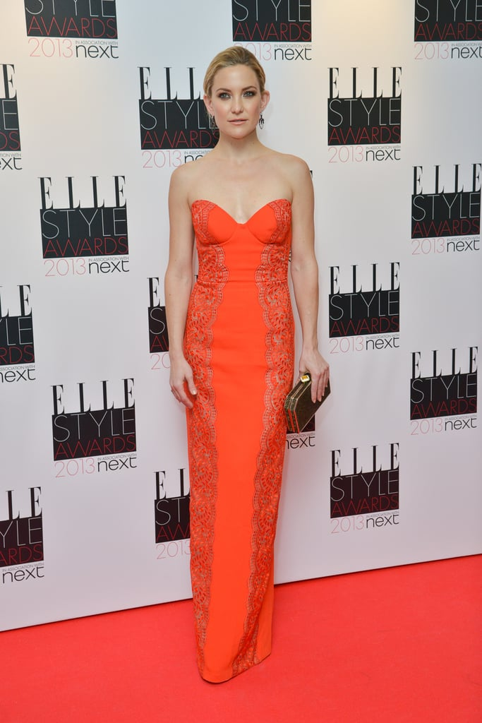 Kate Hudson matched the red carpet in her Stella McCartney red silk embroidered strapless gown from the Fall Autumn 2013 collection.