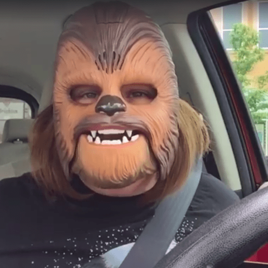 Woman Trying On Chewbacca Mask Video