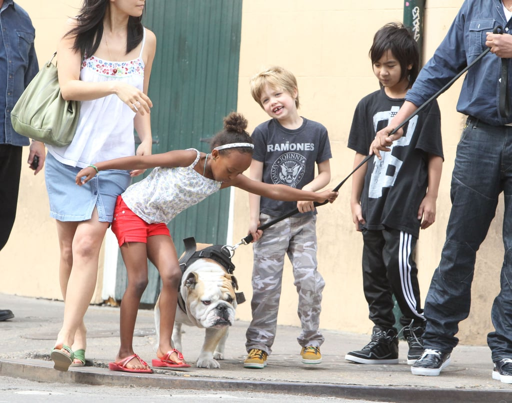 Zahara, Maddox, and Shiloh took the family bulldog, Jacques, for a walk in New Orleans in March.