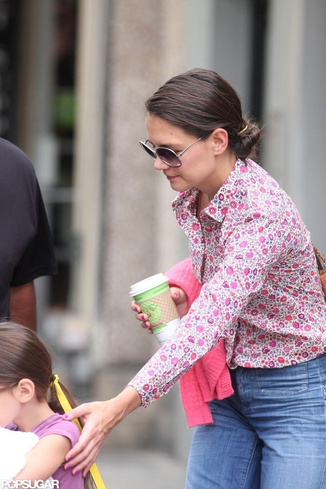 Katie Holmes guided daughter Suri Cruise.