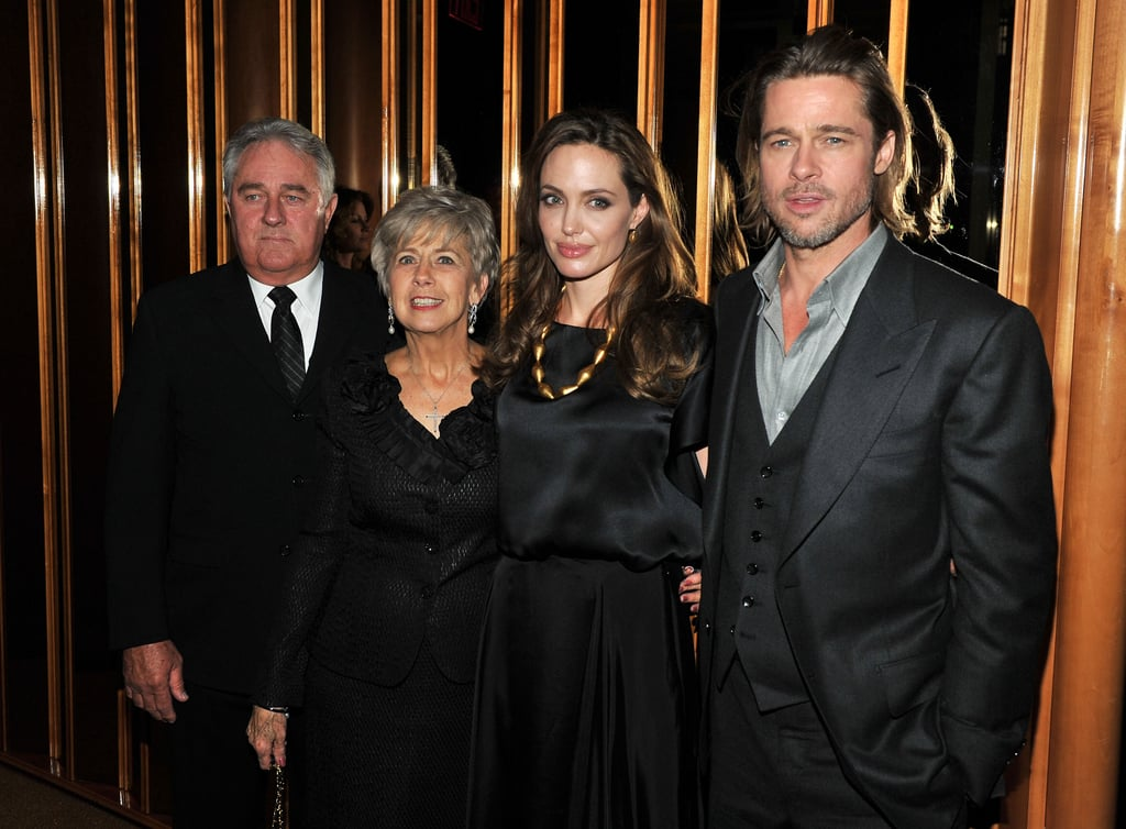 Angelina Jolie at an afterparty with Brad, Bill, and Jane Pitt.