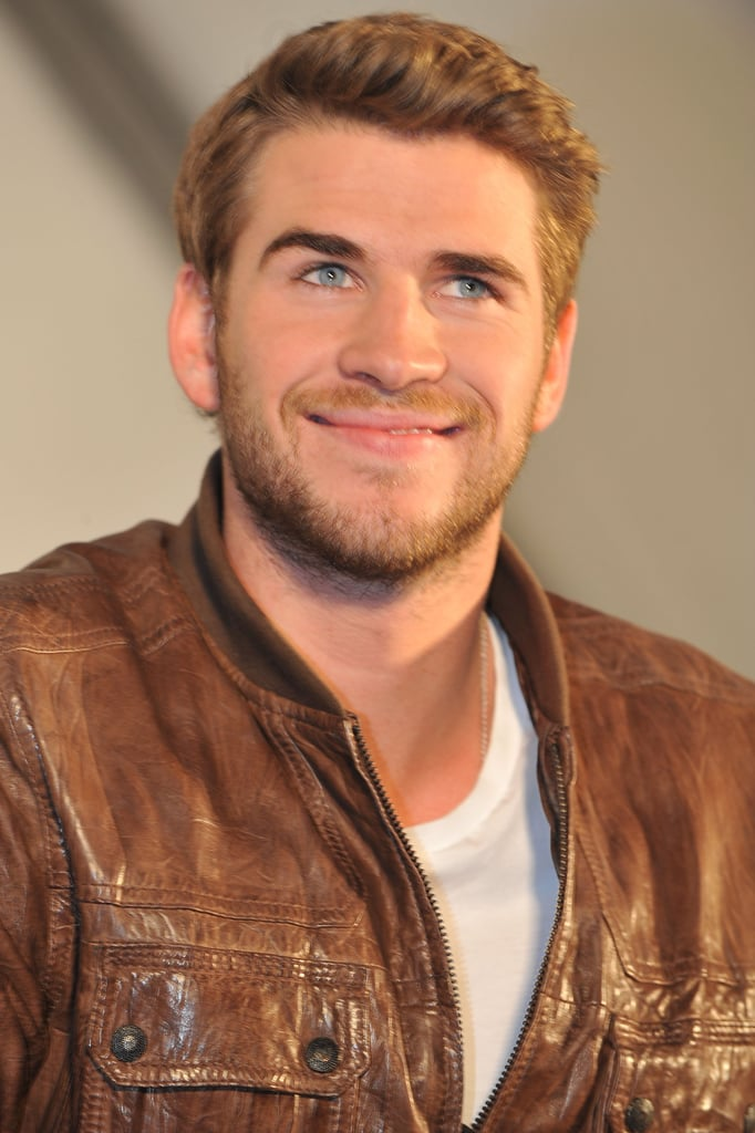 Liam Hemsworth donned a leather jacket at his event.