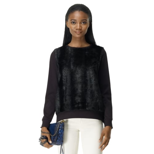 Two reasons why we're falling for this  Club Monaco mona faux-shearling sweatshirt ($130): the chic-meet-casual silhouette and the budget friendly price tag.