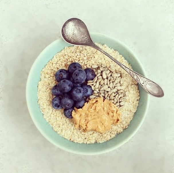 This bowl looks like a study in pastels: blueberries, sunflower seeds, and peanut butter round out the breakfast.