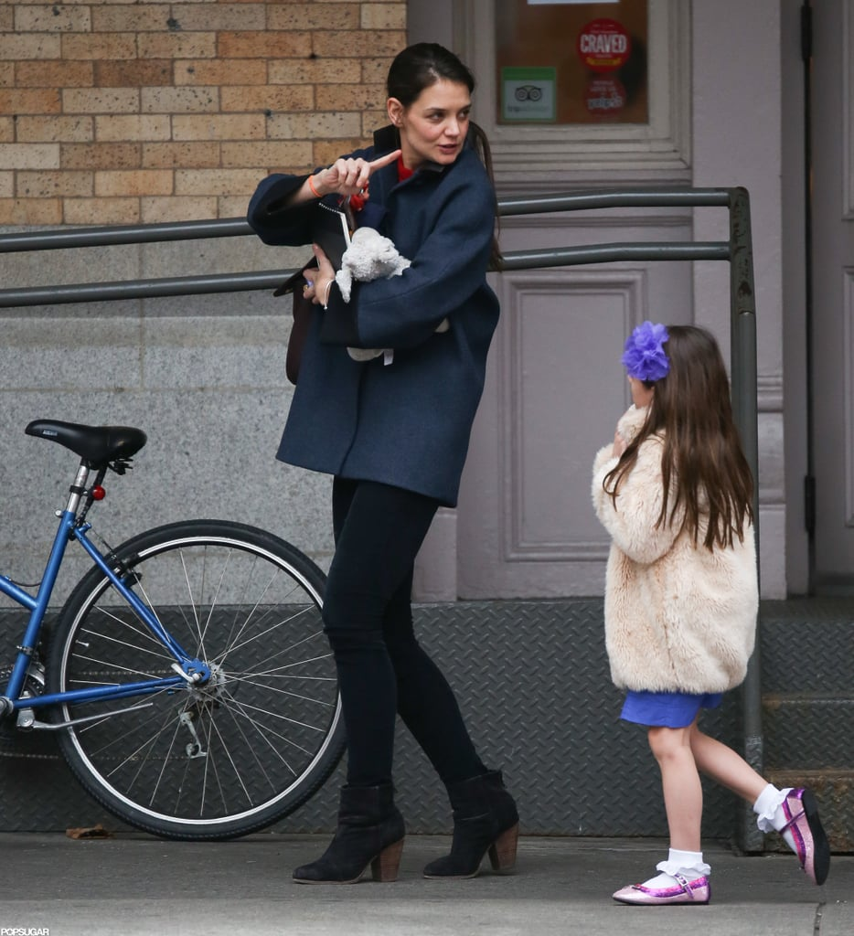 Katie Has Her Hands Full During Chilly Outing With Suri