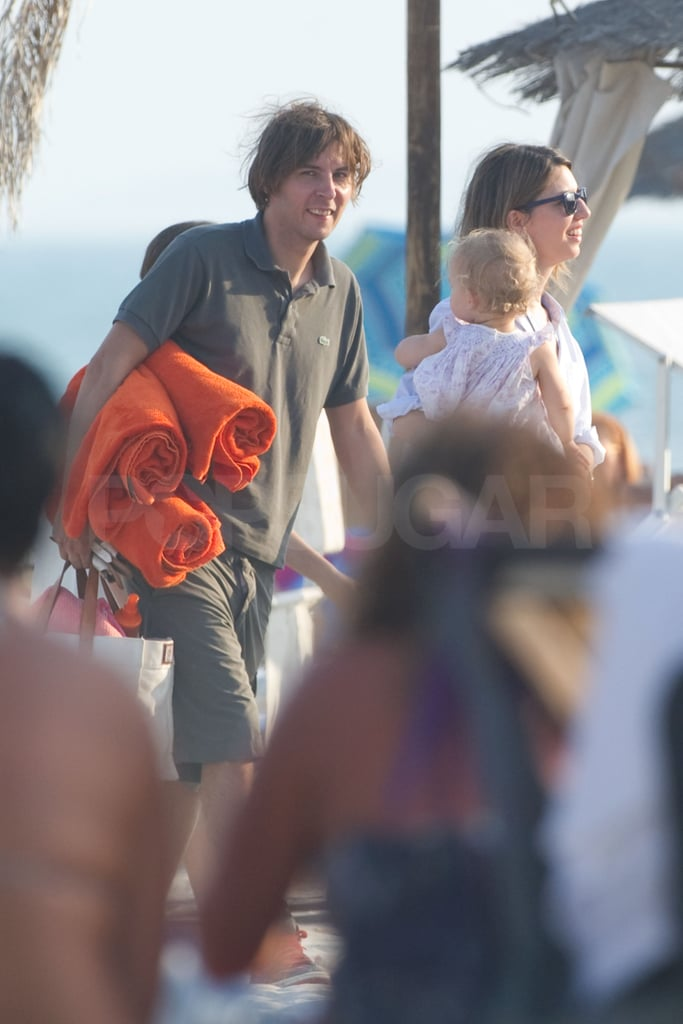 Thomas carried bright towels for his girls.