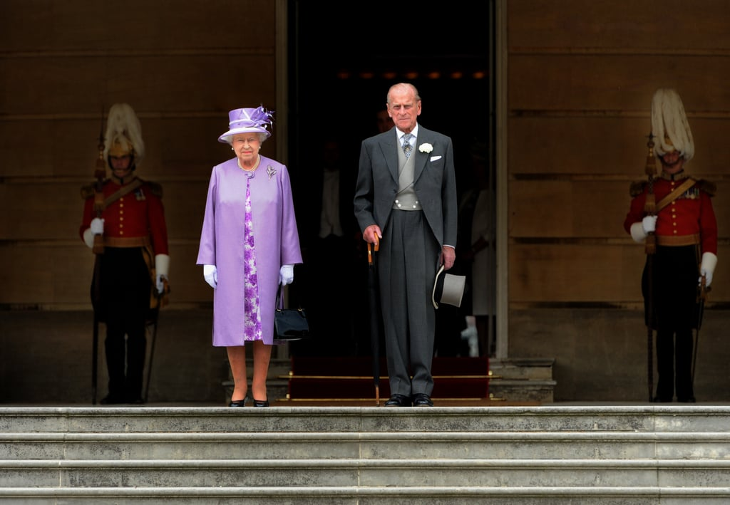 Queen Elizabeth II and Prince Philip, Duke of Edinburgh, stood for the national anthem as they attended a garden party at Buckingham Palace on May 29.