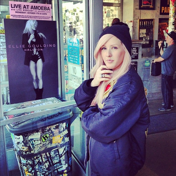 Ellie Goulding posed next to a promotional photo of herself. Source: Instagram user elliegoulding