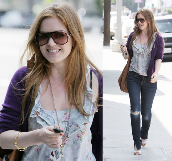 Isla Fisher Hangs Out With Courteney Cox Arquette Wearing Kimchi Floral Top and J Brand Ripped Jeans