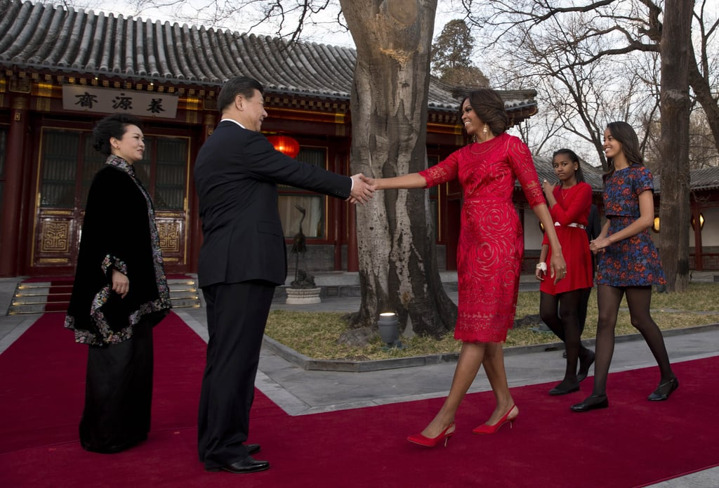 Michelle and her daughters were greeted by the Chinese president in Beijing.