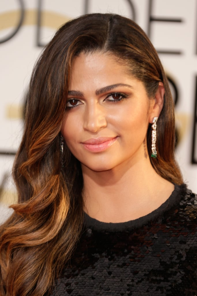 Camila Alves's romantic sideswept curls are what we dream of every morning. Brushed-up brows and smoldering eyes completed her golden goddess red carpet moment.