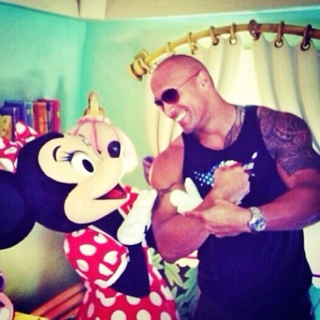 "Dwayne Johnson had fun with Minnie Mouse. He claims, ""She's a muscles, rough hands and tattoos kind of gal."" Source: Instagram user therock"