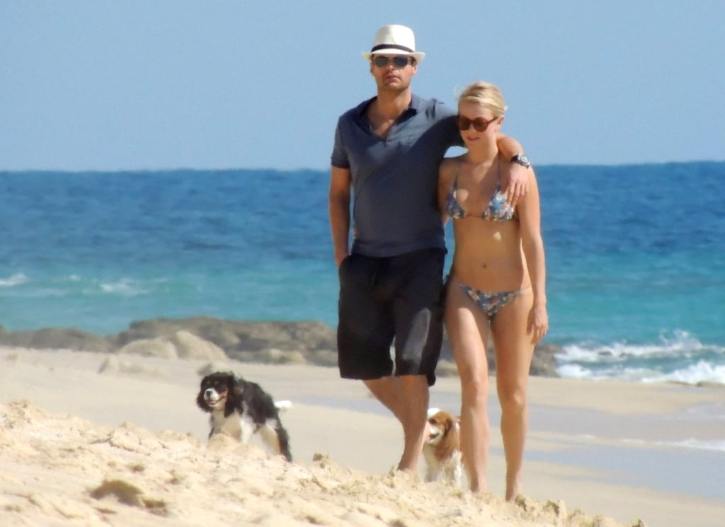 Julianne Hough and Ryan Seacrest took her dogs for a walk on the beach in Cabo in November 2012.