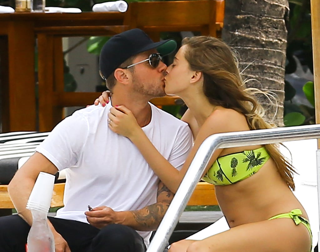 Ryan Phillippe and Paulina Slagter shared a sweet smooch by the pool in Miami in June 2014.