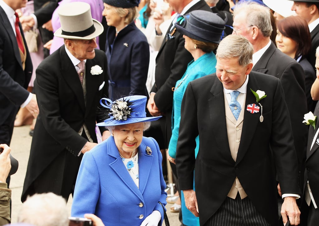 The queen greeted people at the races.