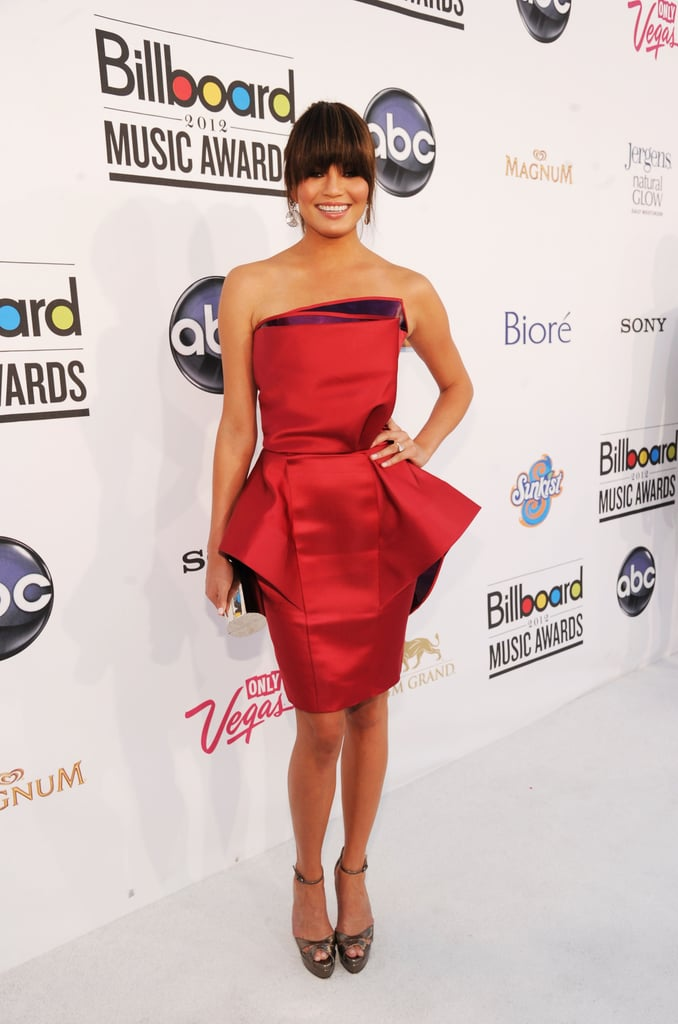 Chrissy Teigen chose a peplum-silhouette minidress, in a fiery bright red hue no less, for the awards show. She polished it off with platform ankle-strap sandals.