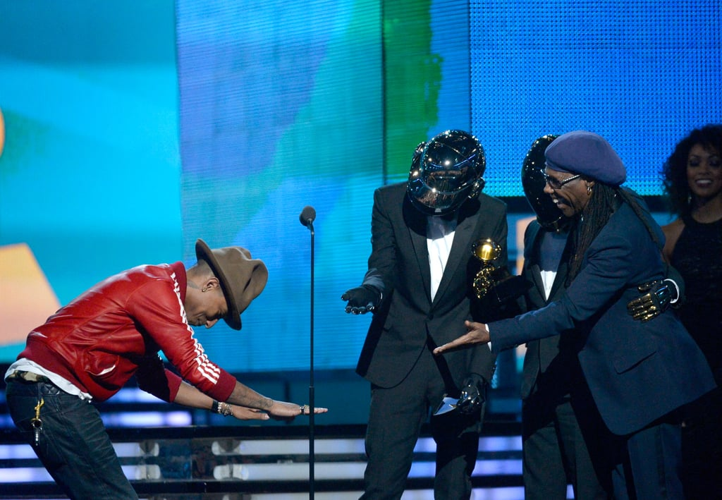 """Pharrell Williams bowed down to Daft Punk as the duo accepted its award for """"Get Lucky."""""""