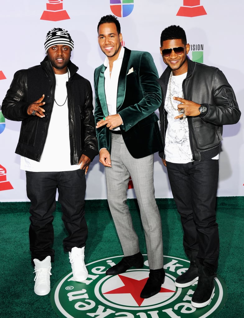 Rico Love, Romeo Santos, and Usher posed together at the Latin Grammy Awards.
