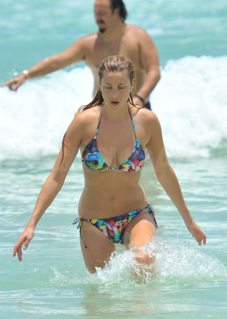 Whitney Port walked through the waves.